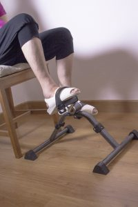 senior woman using pedal exerciser
